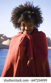 Woman with red blanket