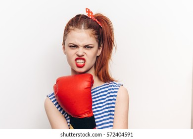 woman in red boxing gloves on a white background red lips.