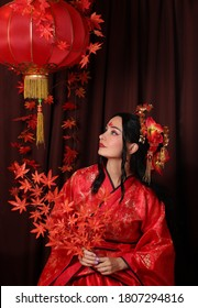 a woman in red Chinese national traditional costume. red Chinese lantern.