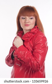 woman in a red coat on a white background in the studio