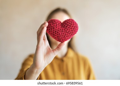 Woman with a red crocheted heart