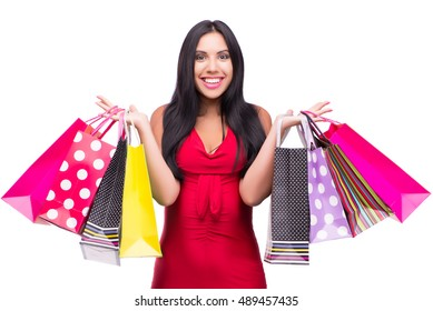 Woman in red dres after shopping isolated on white