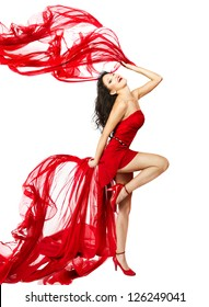 Woman  in red dress dancing with fabric flying on a wind flow. Isolated over White background