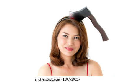 Woman in red dress with fake axe on head on white background. Concept for funny playing costume in halloween festival.