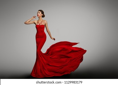 Woman Red Dress, Fashion Model in Long Silk Sexy Gown, Waving Flying Fabric Tail Train, Cloth Fluttering on Wind