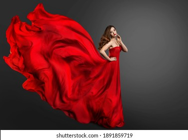 Woman Red Dress, Fashion Model in Long Silk Gown Waving on Wind, Fantasy Girl in Flying Fabric. Black Background