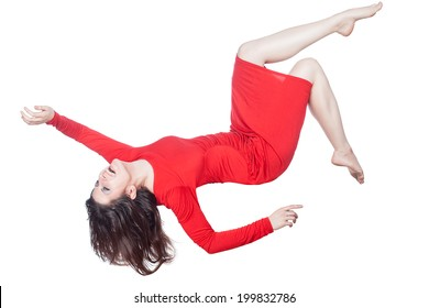 Woman in red dress floating in the air falling on a white background.