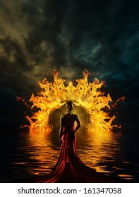 Woman in red dress at the gate of hell