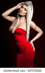 woman in red dress on dark background