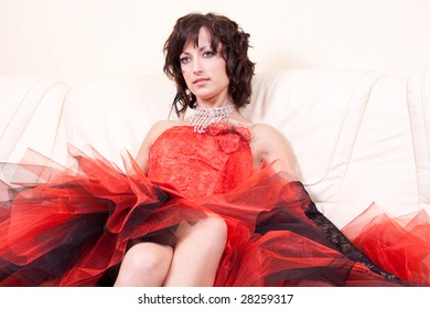woman in a red dress posing in the interior