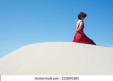 Woman in red dress unzips back