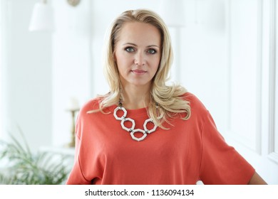 Woman in red dress wearing a handmade necklace