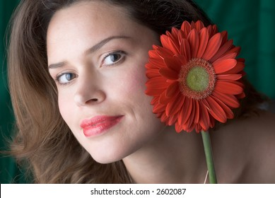 Woman with red gerber portrait