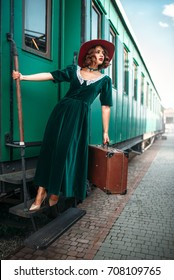 Woman in red hat on vintage steam locomotive
