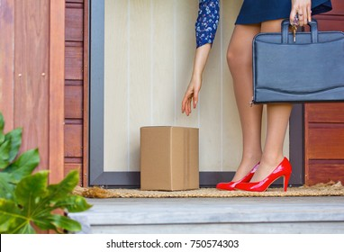 Woman in Red Heels collects parcel at front door of home