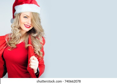 A woman in a red jacket and Santa Claus hat