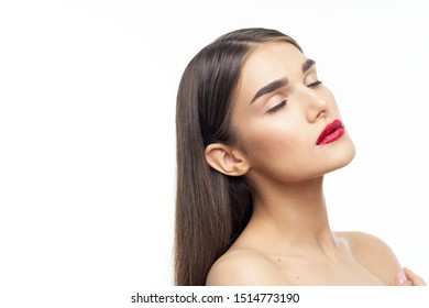 Woman with red lips closed eyes naked shoulders dark hair isolated background