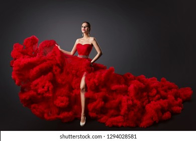 Woman in Red Ruched Dress, Fashion Model in Long Fluffy Waving Gown, Beautiful Girl Studio Portrait
