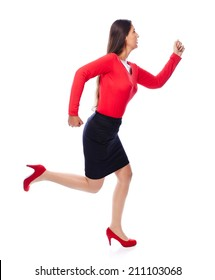 Woman in red running sideways, is short on time isolated on White
