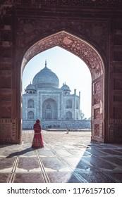 Woman in red saree/sari in the Taj Mahal, Agra, Uttar Pradesh, India