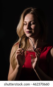 Woman in red sexy dress on dark background