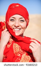 woman in red shawl in desert