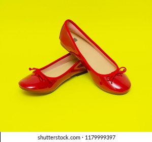 Woman red shoes isolated on the yellow background