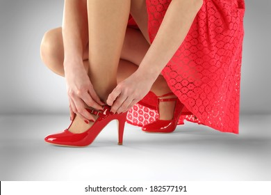 woman in red skirt on gray background