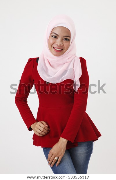 woman with red tudung posing