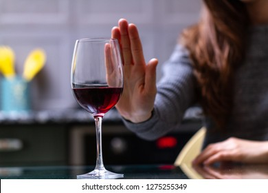 Woman refuses to drink a alcohol. Female alcoholism concept. Treatment of alcohol addiction. Quit booze and alcoholism.
