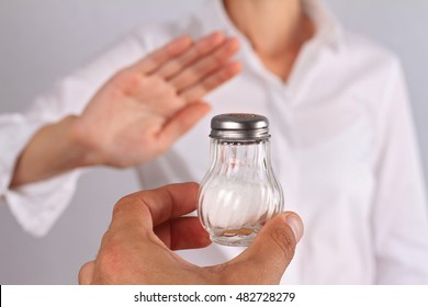 Woman refusing salt. Health care concept, hypertension prevention