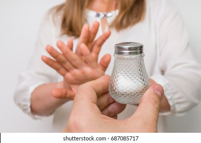 Woman refusing salt using gesture stop - health care concept