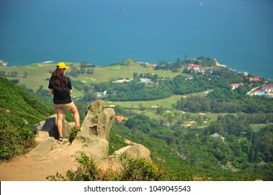 Woman Relax at the Cliff of Dragon's Back Mountain, Hong Kong