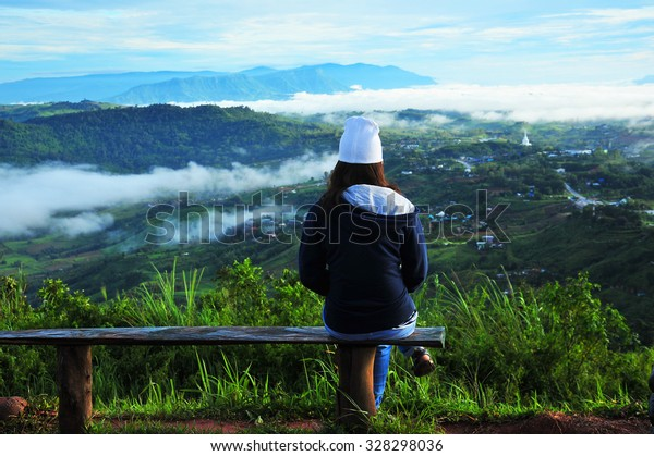 A Woman Relax on The Top of The Hill