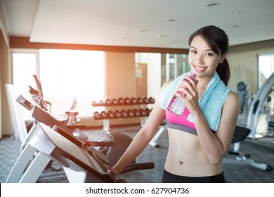 woman relax and stand on treadmill in the gym