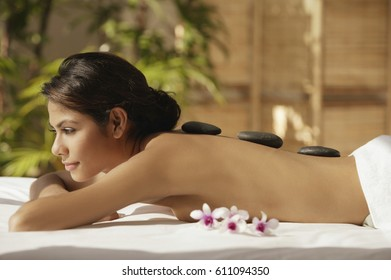 A woman relaxes at a spa