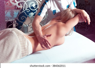 woman relaxing back massage in the spa salon. health, beauty, resort and relaxation concept
