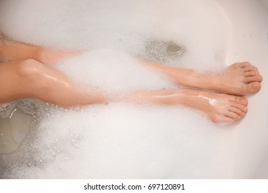 Woman relaxing in bath with foam