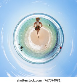 A woman relaxing at the beach of Koggala from a tiny world perspective