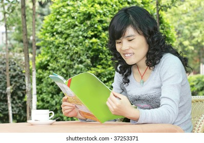 woman relaxing with a coffee and a magazine