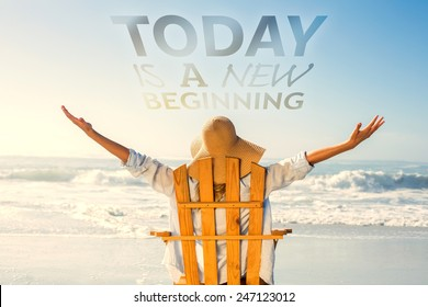 Woman relaxing in deck chair by the sea against today is a new beginning