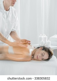 Woman relaxing during pleasant massage in beauty salon