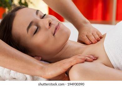 Woman relaxing during professional shoulder massage, horizontal