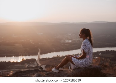 Woman relaxing and enjoying a fantastic view