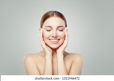 Woman relaxing. Eyes closed. Young perfect female face. Spa treatment, skincare and cosmetology concept.