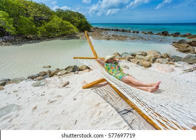Woman relaxing in a hammock. Aruba island