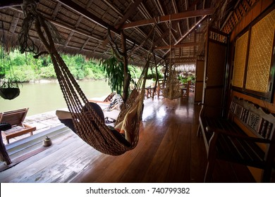 Woman relaxing in the hammock on a floating resort, Thailand