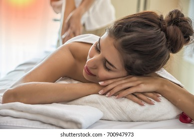 woman relaxing with hand massage at beauty spa.