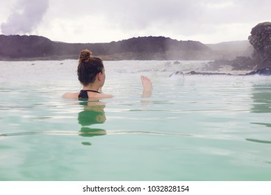 Woman Relaxing In Hot Spring Outdoor At Iceland
