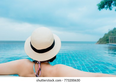 Woman Relaxing In Infinity Swimming Pool Water. Looking At Sea View, Travel Vacation concept